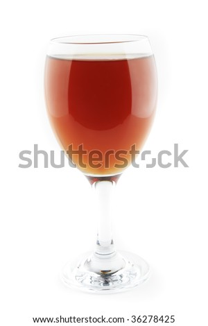 apple juice inside transparent glass over white