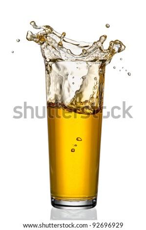 Apple juice splash isolated on white - stock photo
