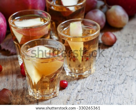 Apple juice with slices of fresh apples in the autumn background, selective focus - stock photo