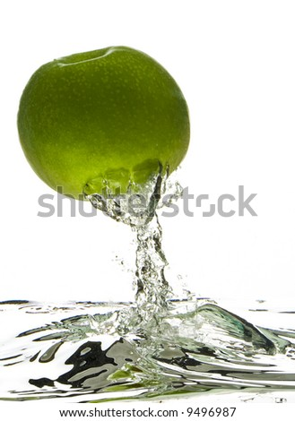 Apple jump out from water. A hand made of water hold them. - stock photo