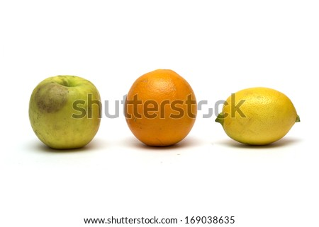 Apple, lemon and orange on a white background. Photo.