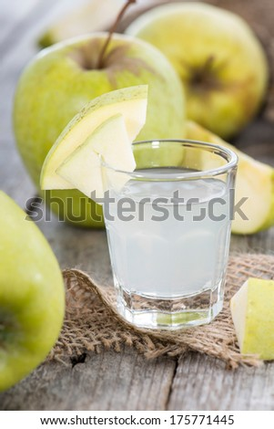 Apple Liqueur in small glasses with fruits