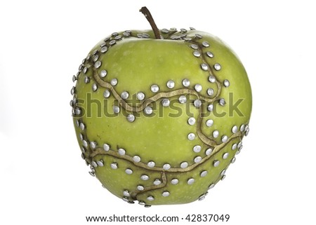 apple manipulated fruit with nails holding it together - stock photo