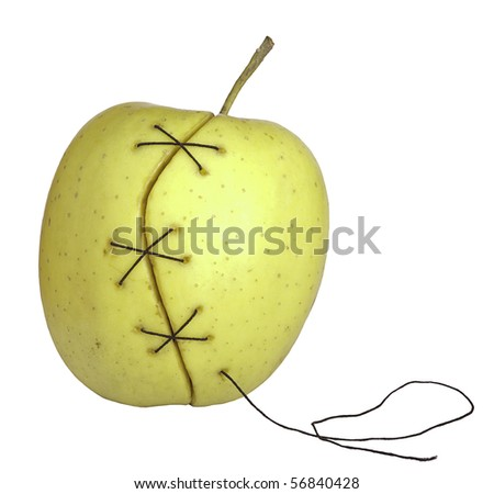 apple manipulated fruit with thread holding it together - stock photo