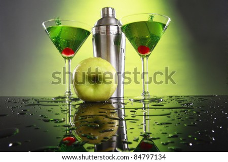 Apple martini and shaker - stock photo