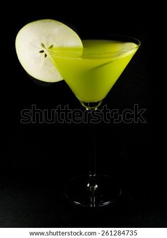 Apple martini on black background - stock photo