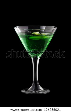 Apple-melon martini coctail isolated on black background - stock photo