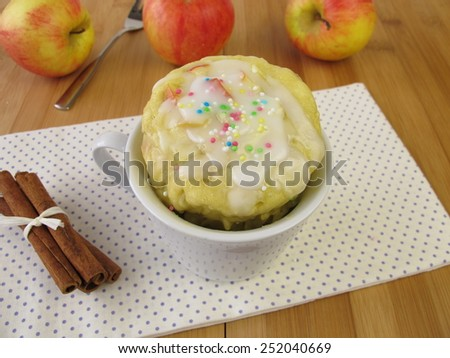 Apple mug cake with sugar icing from microwave  - stock photo