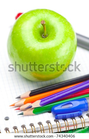 apple, notebooks and pencils isolated on white - stock photo