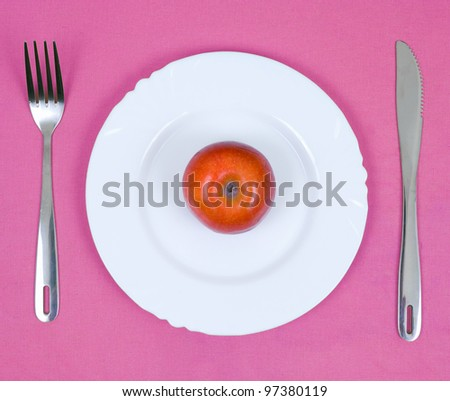 apple on a plate - stock photo