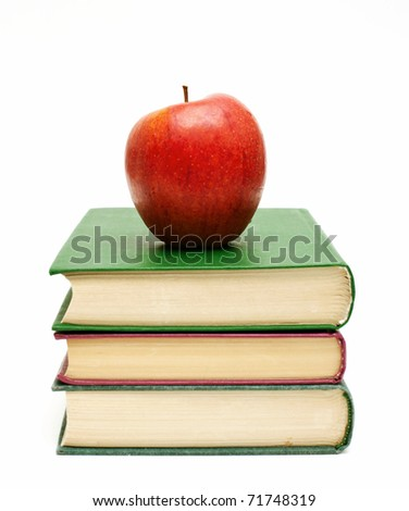 apple on a stack of books - stock photo