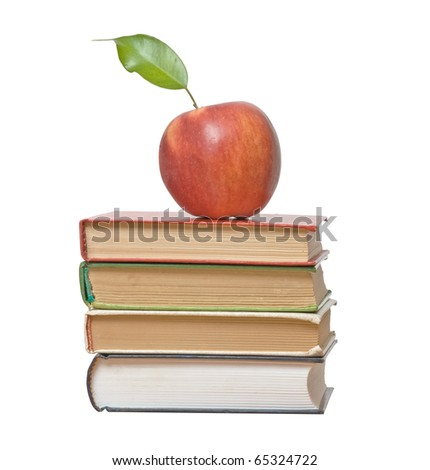 Apple on book isolated on white background