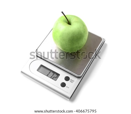 Apple on digital kitchen scales, isolated on white - stock photo