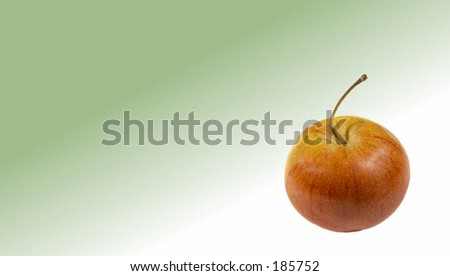 Apple on faded green background