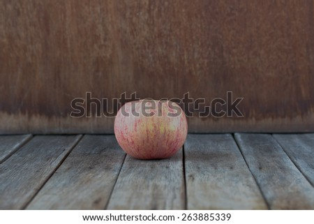 apple on gray old wooden table - stock photo