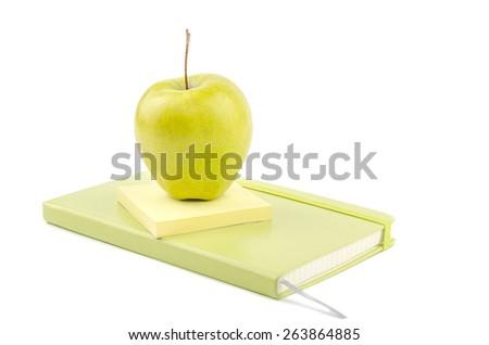apple on notepad - stock photo