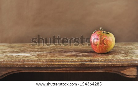apple on on the brown background - stock photo