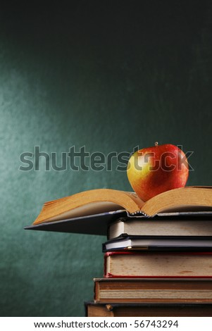 apple on stack of book - stock photo