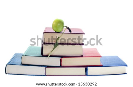 apple on stack of books - stock photo