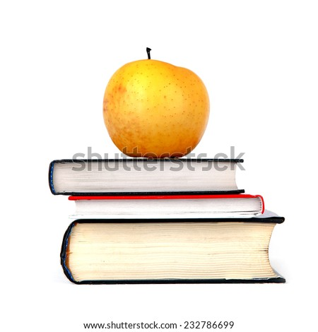 Apple On The Books Isolated on the White Background - stock photo