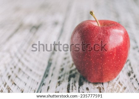 Apple on wooden background - processing still life effect style picutres - stock photo