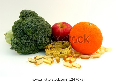 Apple,orange, broccoli,fish oil caplets and measure tape - stock photo