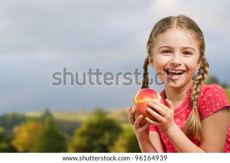 Apple orchard - lovely girl with red apple - stock photo