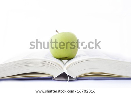 apple over a open book isolated on white
