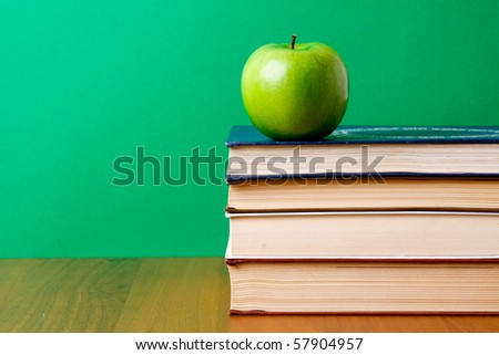 apple over books - stock photo