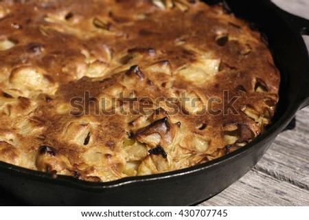 Apple pancake in a cast iron skillet - stock photo