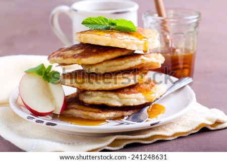 Apple pancakes with maple syrup - stock photo