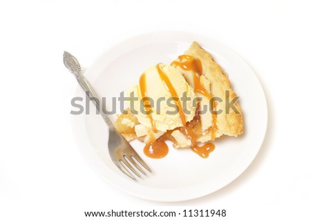 Apple pie a la mode drizzled with caramel sauce. - stock photo