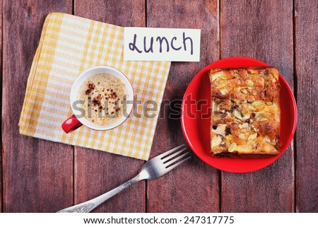 Apple pie and a cup of cappuccino on the table, top view. The concept of lunch, warm and homely atmosphere and a dessert. - stock photo