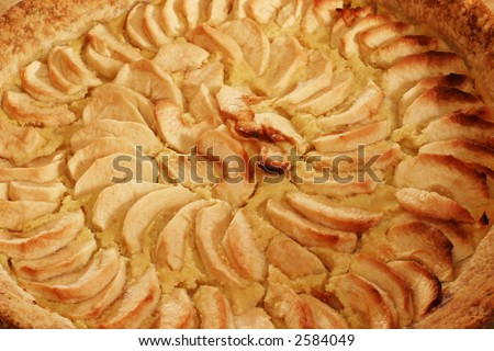 Apple Pie - closeup - Homemade French authentic classic recipe.  The apple slices are laid on top of a custard layer. - stock photo