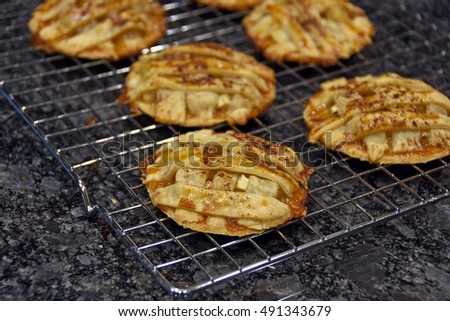 apple pie cookies cooling on metal rack