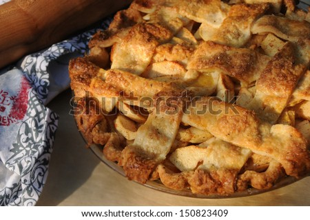 Apple Pie Cooling in the Afternoon Light - stock photo