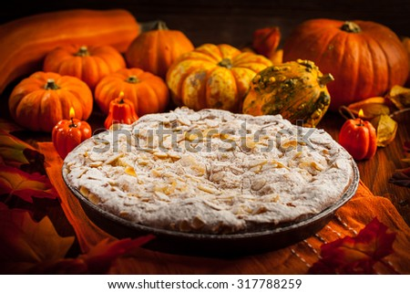 Apple pie for Thanksgiving with pumpkins - stock photo