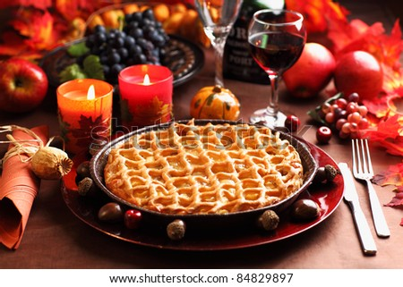 Apple pie for Thanksgiving with wine and grapes - stock photo