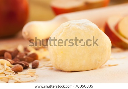 Apple pie ingredients. Dough, apple slices and almonds. - stock photo