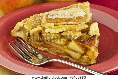 apple pie on a red plate - stock photo