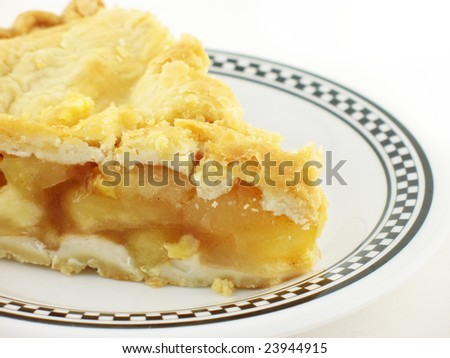 apple pie on a white and black checkered plate on white