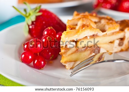 Apple pie served with red currants and strawberry. - stock photo