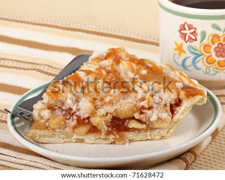 Apple pie topped with caramel and cup of coffee in background - stock photo