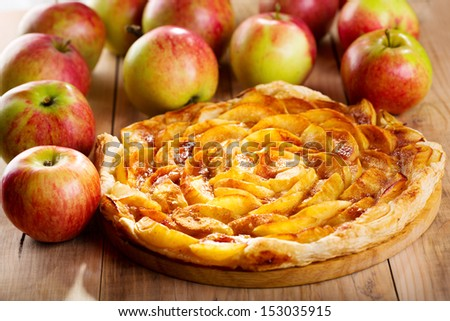 apple pie with fresh fruits on wooden table - stock photo