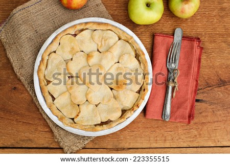 Apple pie with heart shaped crust topping, shot from above.  - stock photo