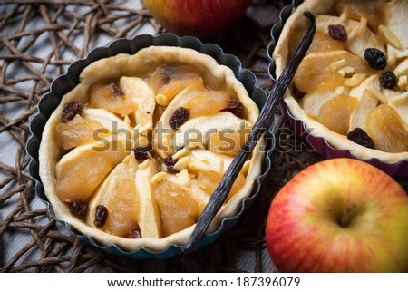 apple pies with raisins and vanilla - stock photo