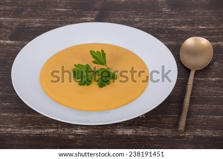 Apple pumpkin cream soup in a dish - stock photo
