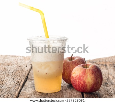 Apple shake with fresh apple on old wood table - stock photo