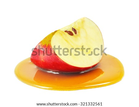 apple slice with honey isolated on a white background