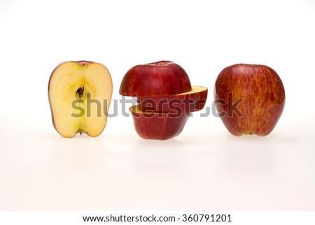 Apple sliced sections on white background - stock photo
